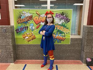 Teacher dress in super hero outfit.