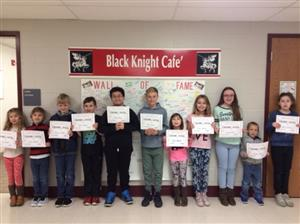 Eleven students pictured with certificates