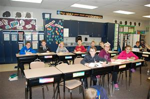Students sitting at their desks.