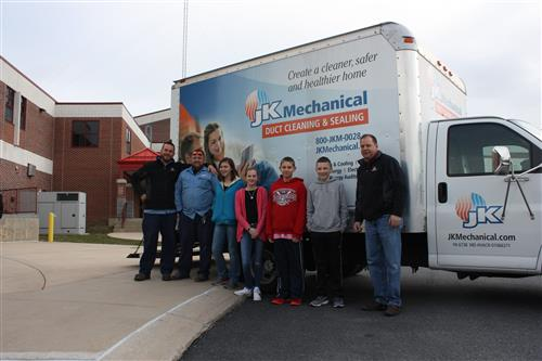 CES students helped load the JK Mechanical with donated food items.