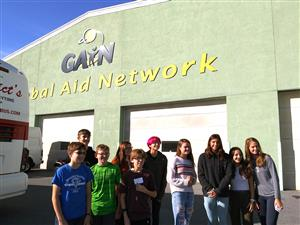 Students stand in a group outside of the GAIN distribution center.